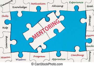 Mentoring concept word cloud on group of jigsaw puzzle...