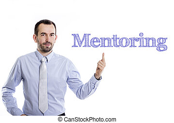 Mentoring - Young businessman with small beard pointing up in blue shirt