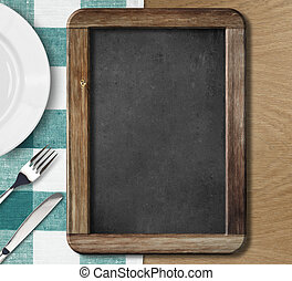 Menu blackboard lying on table