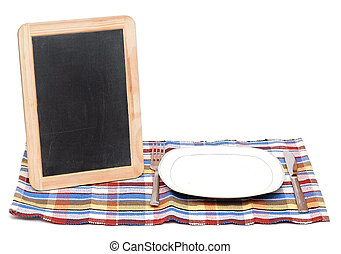 Menu blackboard lying on white background with plate, knife and fork