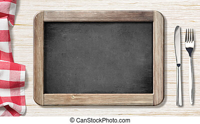 Menu blackboard top view on table with knife and fork