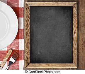 Menu blackboard top view on table with plate, knife and fork