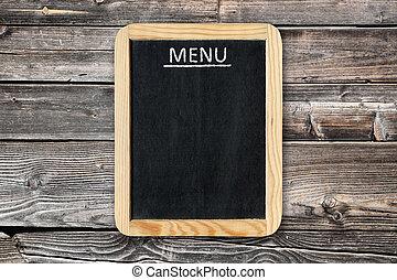 Menu board on wooden wall