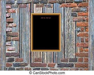 Blank menu blackboard on a wooden wall in red brick frame