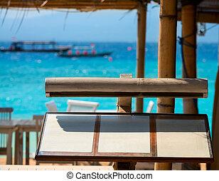 Menu list in outdoor cafe on sea beach