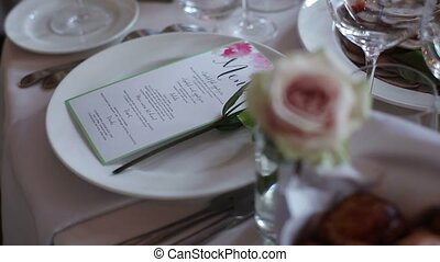 Menu on party in restaurant and rose flower decoration