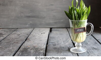 Menu. Wood garlic on vintage table and tag. Copy space.