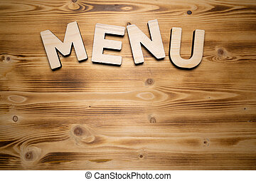 MENU word made with building blocks on wooden board