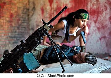 mercenary - Mercenary is taking the gun from the dead body ...