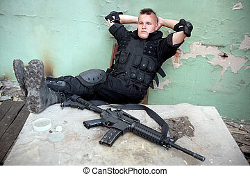 mercenary - Relaxing warrior with the M4 rifle. Focus point...