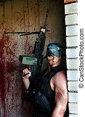 mercenary - Powerful mercenary with submachine gun on the...