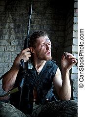 mercenary - Mercenary with \'Kalashnikov\' submachine gun...