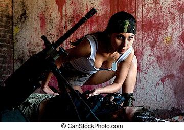 mercenary - Mercenary is taking the gun from the dead body...