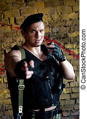 mercenary - Armed mercenary with \'Kalashnikov\' submachine...