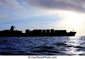 merchant ship cargo back light sea sunshine