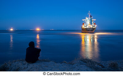 Merchant Ship - VALENCIA - OCTOBER 1: One person observes...
