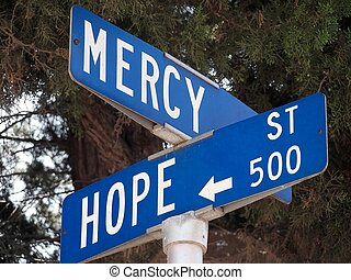 Mercy and Hope - Close-up of street signs at the ...