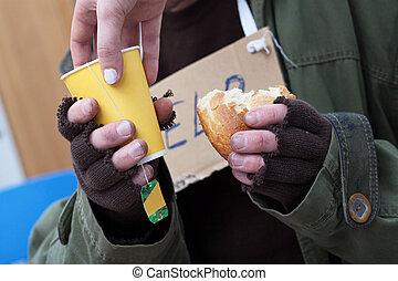 Mercy for poor homeless man - Women giving hot tea to poor...