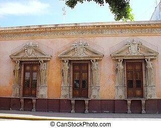 Merida city aged facade in Mexico golden color
