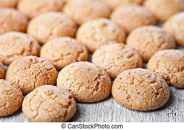 meringue almond cookies closeup on wooden background