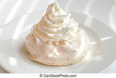 Meringue cake with whipped cream