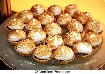 Meringue desserts - Fluffy meringue pastry tart desserts on...