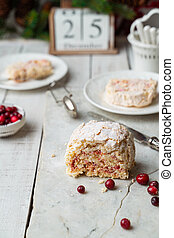 Meringue roulade with cranberries on Nordic style Christmas table, vertical image