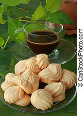 Meringue with cup coffee.