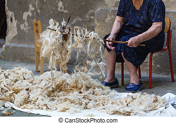 Merino wool in hands of an old woman
