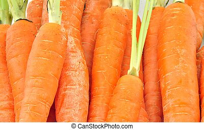 merits of carrots - Fund carrots stacked side by side
