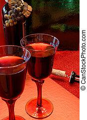 Merlot Wine - Glasses of merlot wine, the bottle with grapes...