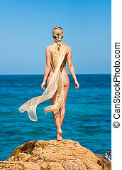 Mermaid - Blond beauty lady standing on the rocks