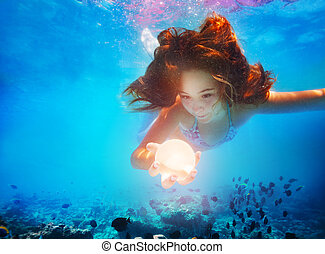 Mermaid girl underwater hold magic ball sphere