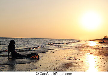 Mermaid Sunset - Photo of a mermaid on the beach by the...