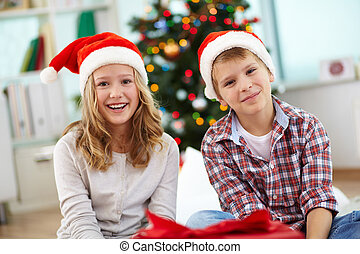 Merriment - Portrait of happy siblings looking at camera on...