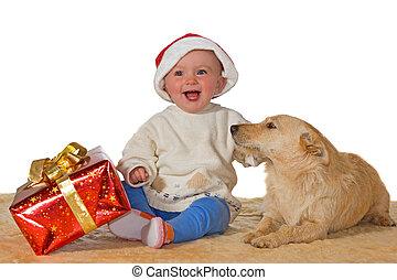 Merry baby enjoying Christmas with dog