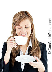 Merry businesswoman drinking a coffee