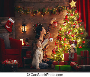 Mom and daughter decorate the Christmas tree. - Merry...
