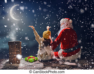 girl and Santa Claus sitting on the roof