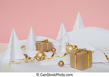 Fairy forest made of white paper with gold balls and gifts on pink background, Christmas holidays concept