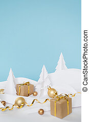 Fairy forest made of white paper with gold balls and gifts on blue background, Christmas holidays concept