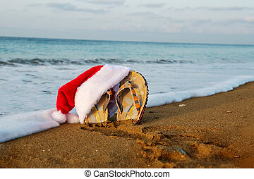 Merry Christmas and happy New year background with Santa Claus hat and thongs.