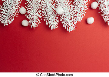 Merry Christmas and Happy New Year greeting card branches frame or banner. White xmas snowflakes and fir tree on red background top view. Winter holiday theme