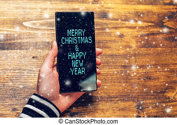Merry Christmas and happy New Year message on mobile phone