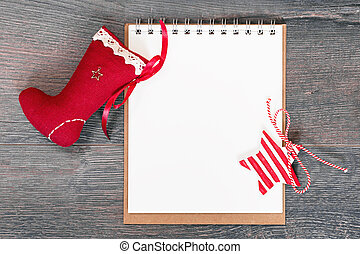 Merry Christmas banner. Christmas stocking with notepad and red star pendant