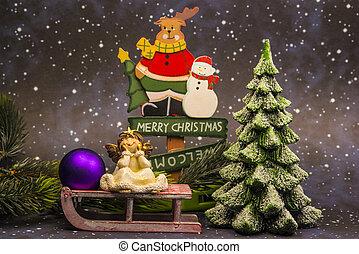 merry christmas board with angel and christmas tree