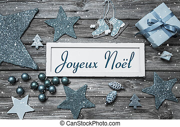 Merry Christmas card in shabby chic style in blue and white with french text on wooden board.