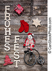 Merry christmas card with german text on wooden background...
