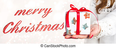 Merry Christmas card with girl holding a present