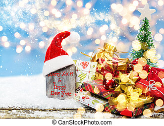 Merry christmas, christmas card with santa hat and gifts